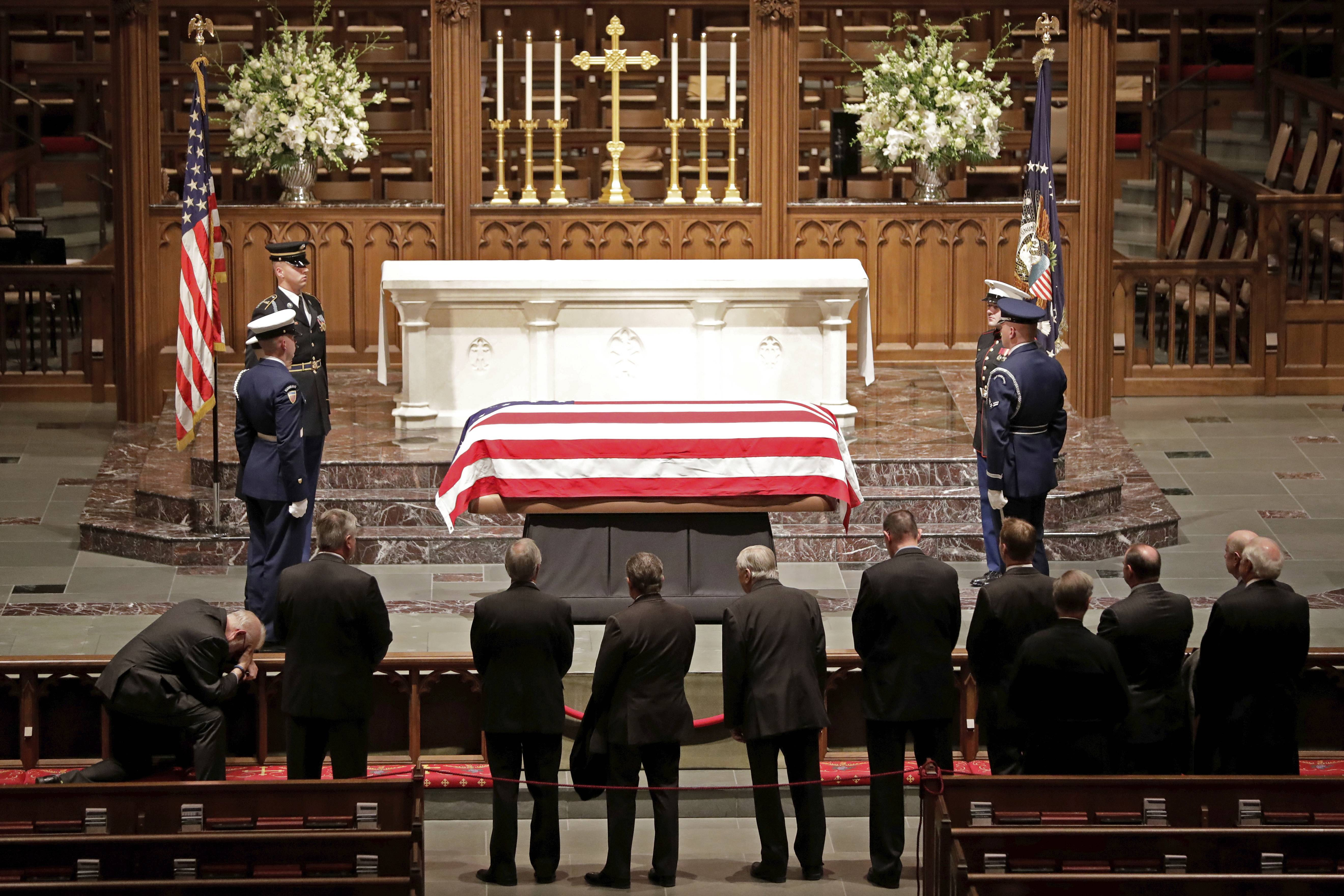 Visitors pay their respects Wednesday to the flag-draped casket of former President George H.W. Bush at St. Martin's Episcopal Church in Houston.