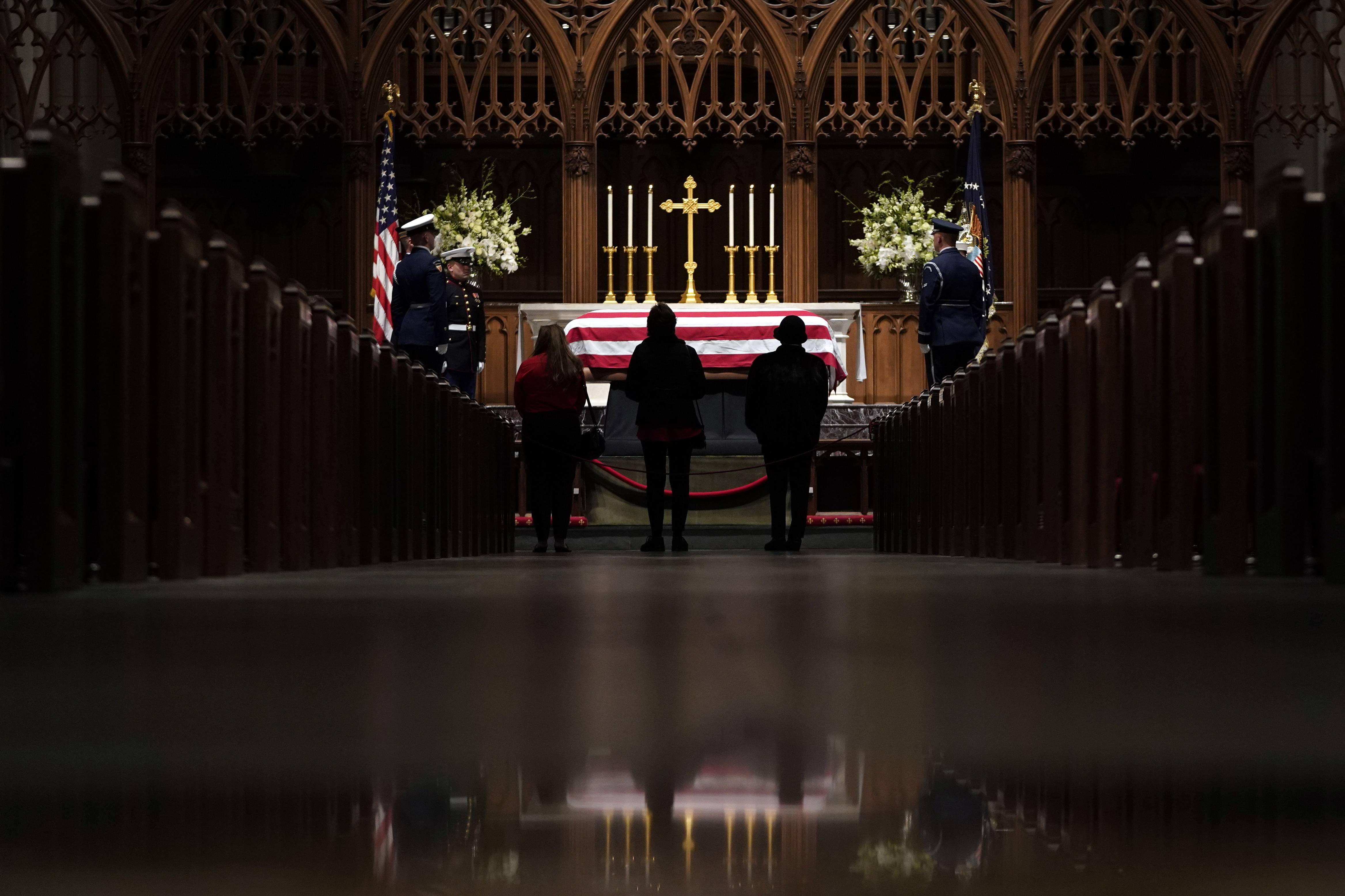 People pay their respects Wednesday as former President George H.W. Bush lies in repose at St. Martin's Episcopal Church in Houston.