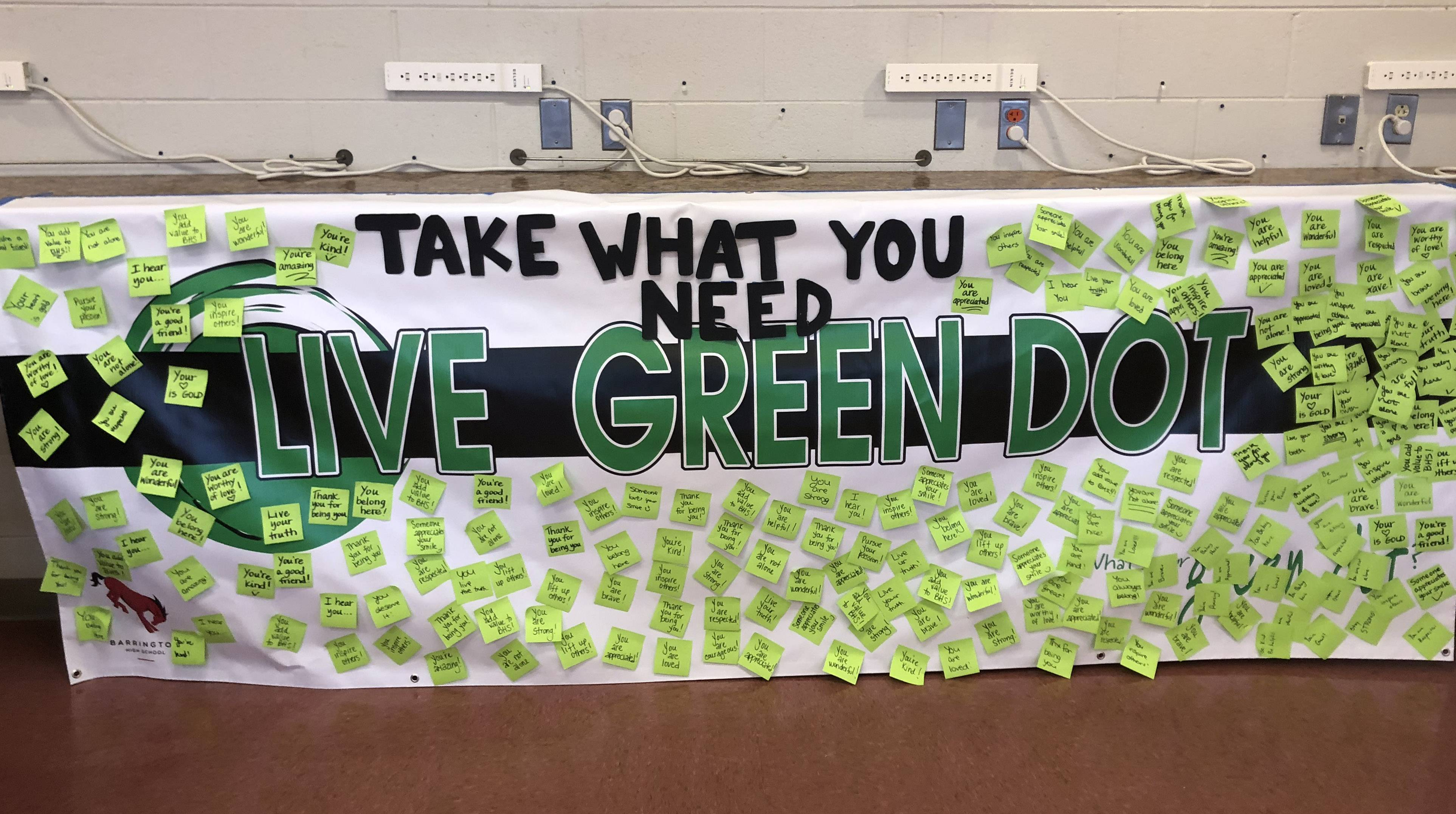 During the May 2018 Mental Health Awareness Month, Barrington High School featured the Green Dot banner with positive messaging in the student cafeteria.