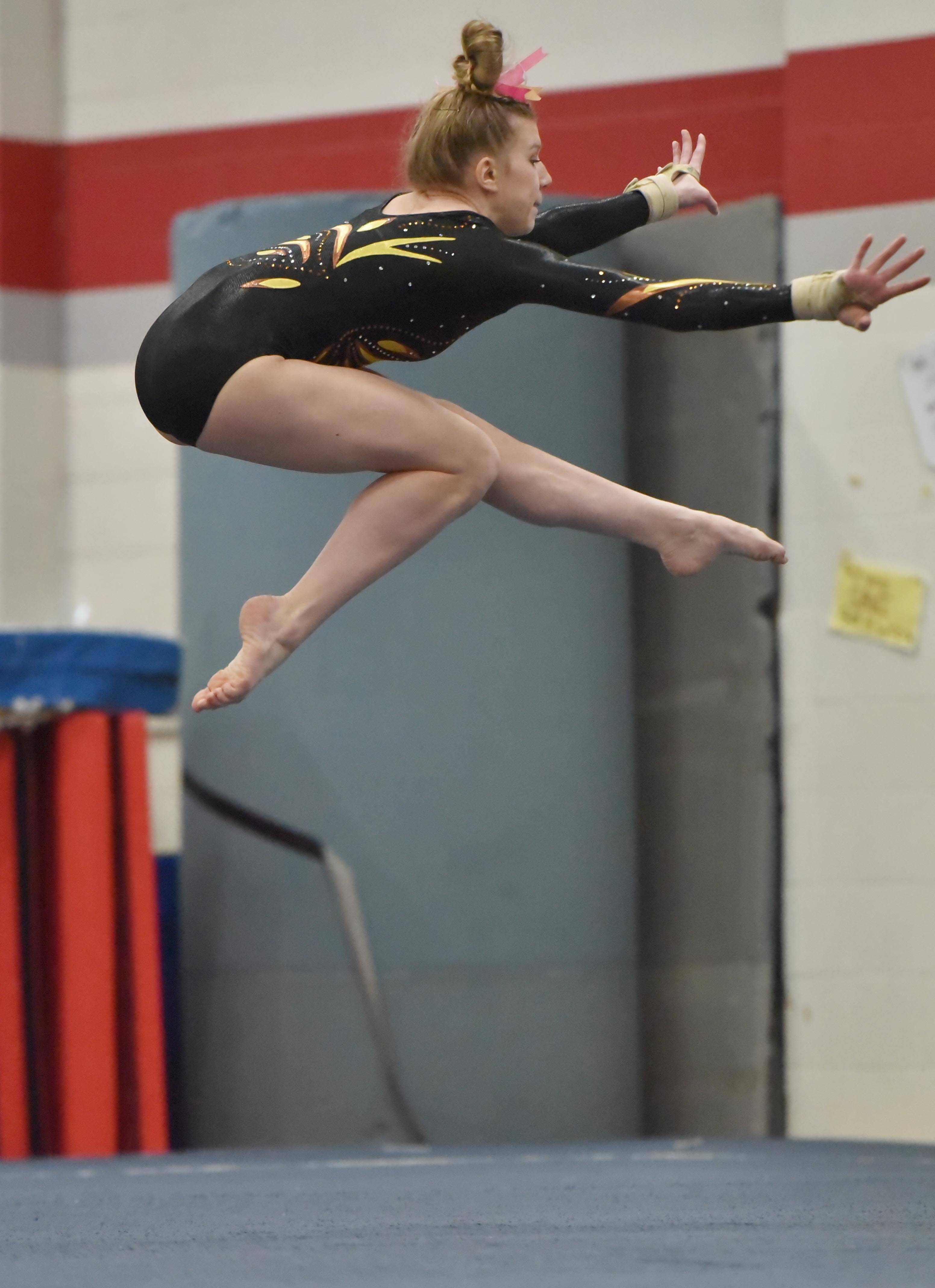 Carmel's Lyndsey Basara in the Floor Exercise routine at the Lake County girls gymnastics meet Saturday at Mundelein High School.