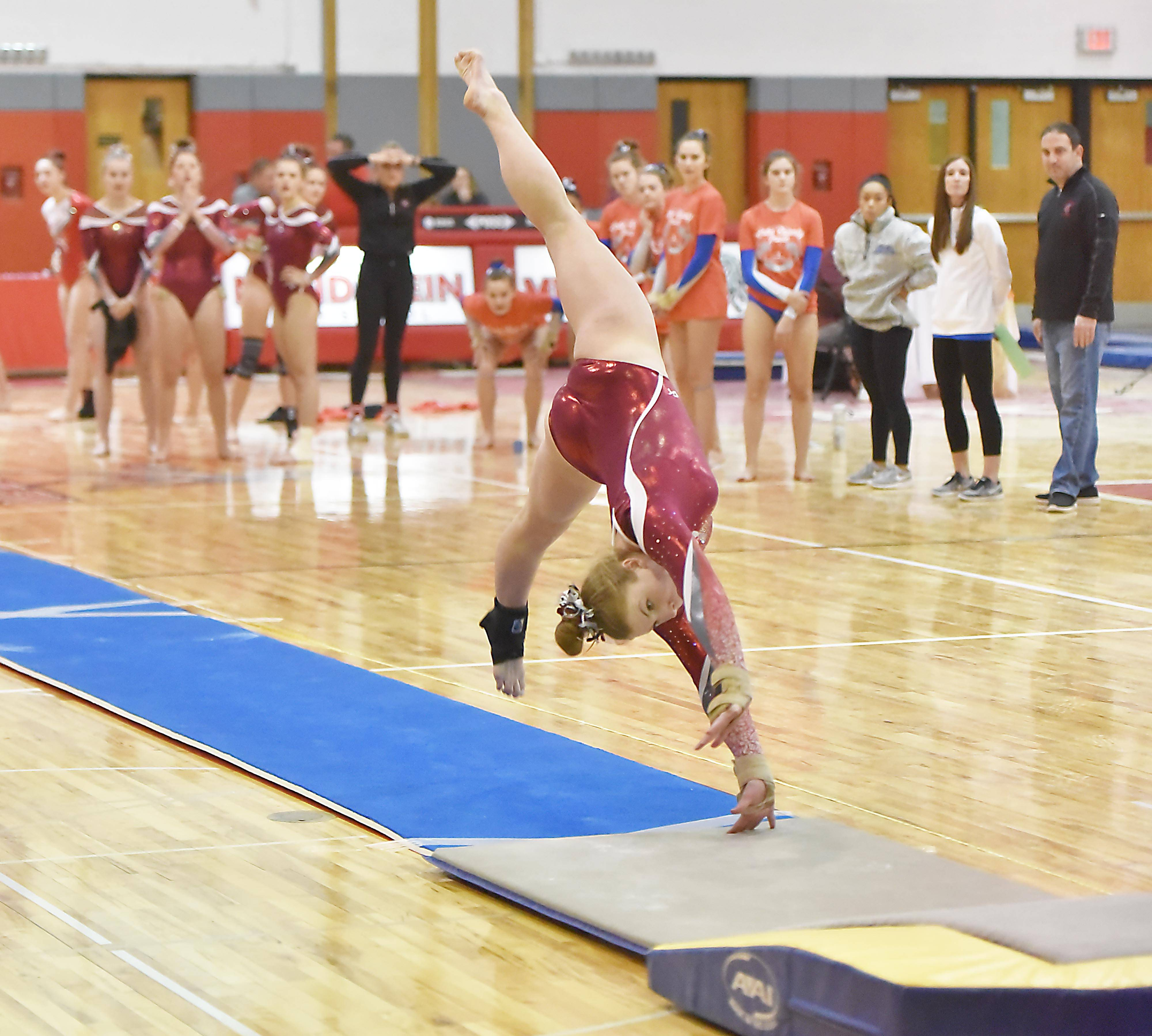 Mundelein's Emma Hallin flips into her Vault at the Lake County girls gymnastics meet Saturday at Mundelein High School.