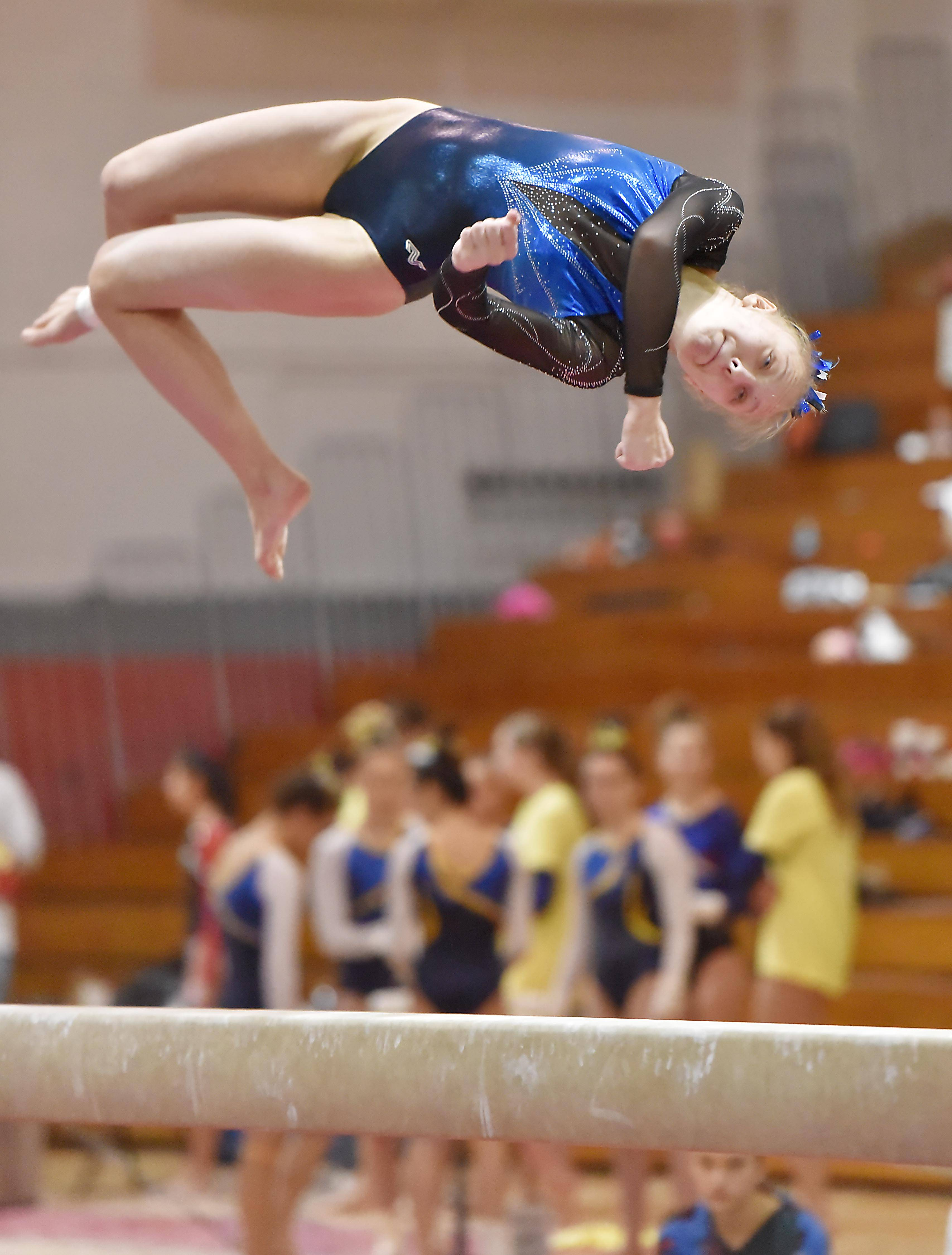 Lake Zurich's Joanna Topa dismounts her Balance Beam routine at the Lake County girls gymnastics meet Saturday at Mundelein High School.