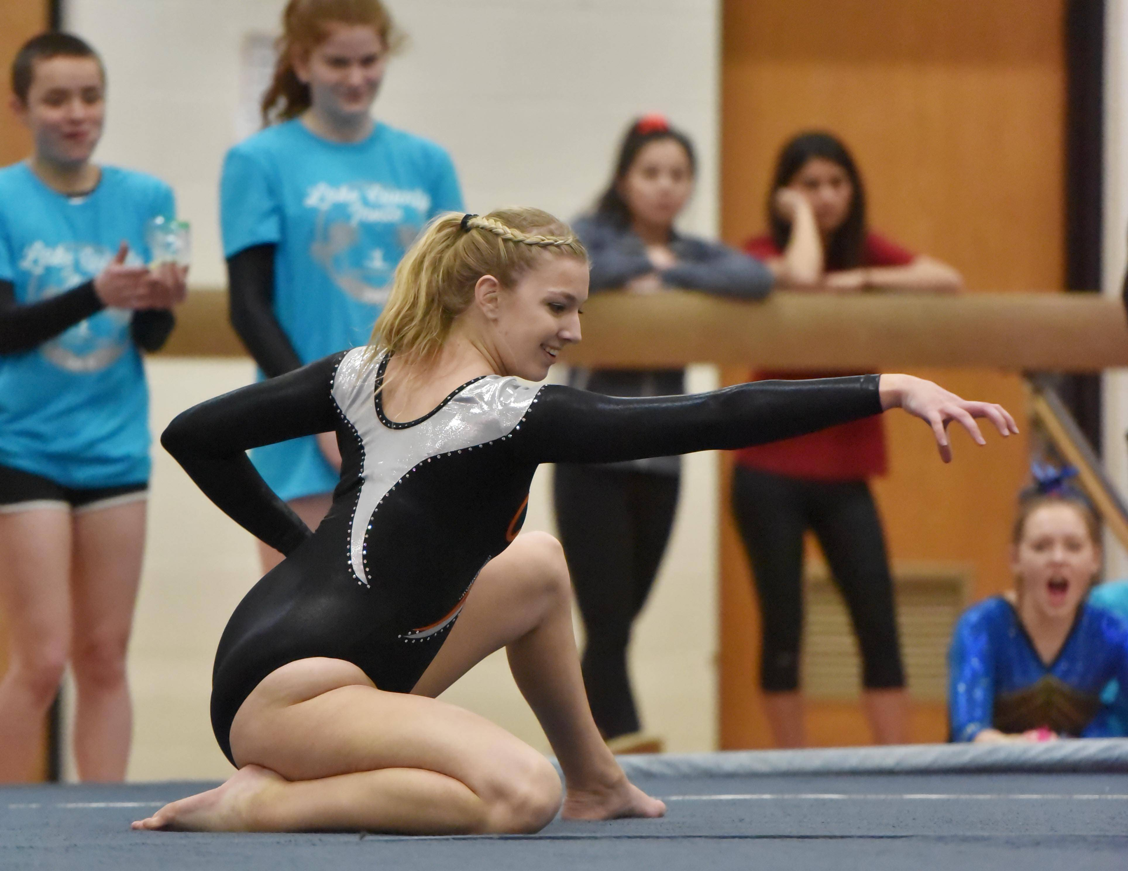 Libertyville's Kylie Skie performs the Floor Exercise at the Lake County girls gymnastics meet Saturday at Mundelein High School.