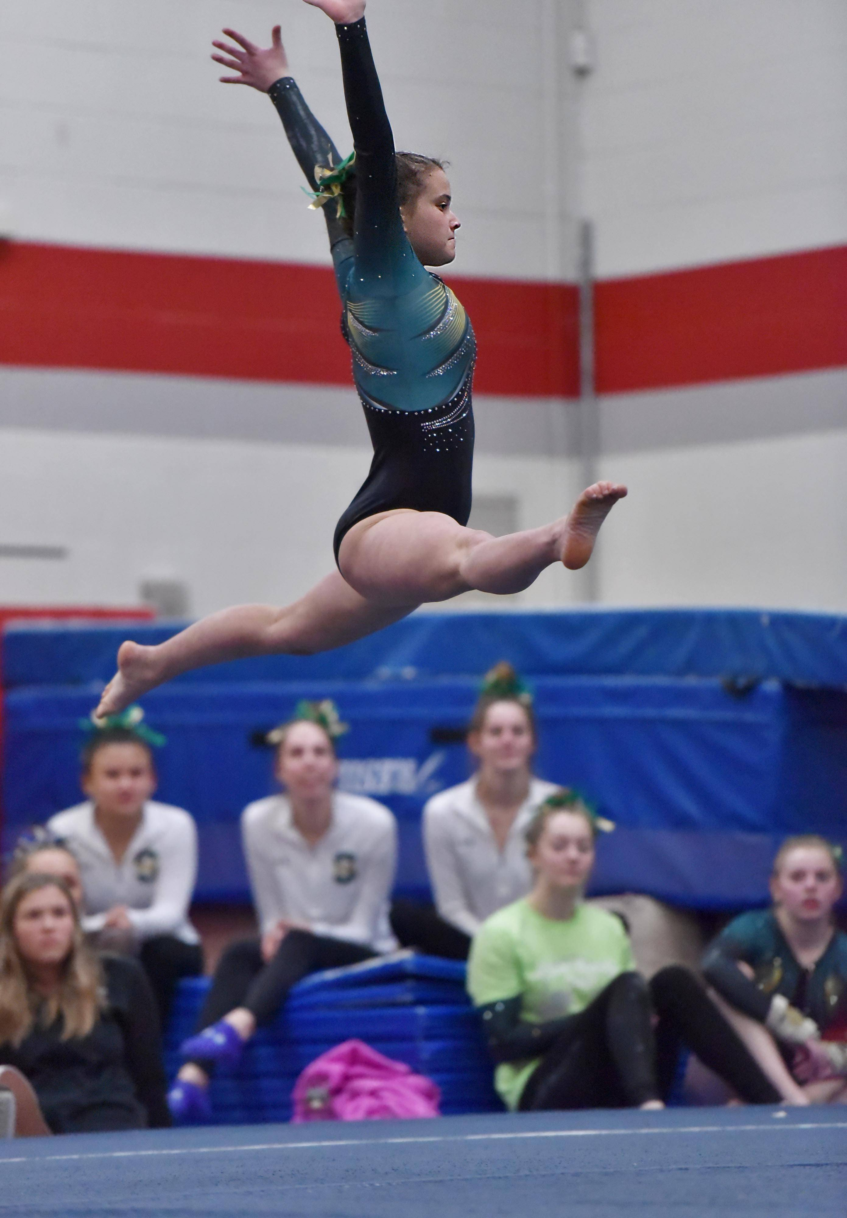 Stevenson's Emily Weinstein on the Floor Exercise at the Lake County girls gymnastics meet Saturday at Mundelein High School.