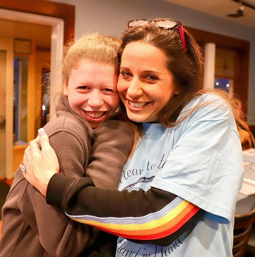 At the recent fundraiser hosted by Jenny Callen, left, Prairie House Owner Tara Joseph gives Callen a hug.