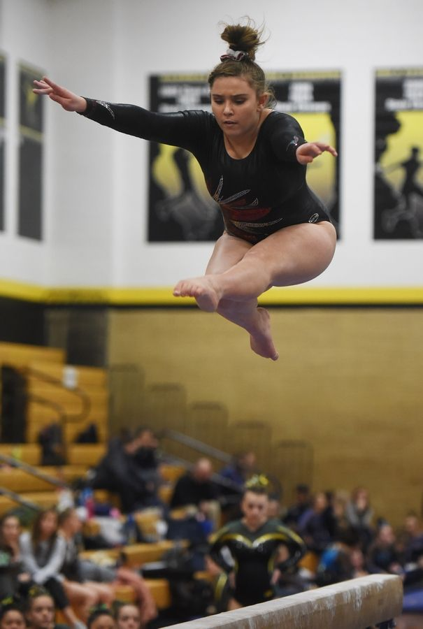 Naperville Central's Lexi Swanson competes on the balance beam during the Hinsdale South girls gymnastics sectional in Darien Tuesday.