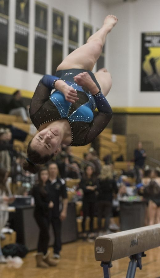 Downers Grove South's Andrea Davenport dismounts from the balance beam during the Hinsdale South girls gymnastics sectional in Darien Tuesday.