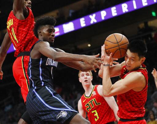 Orlando Magic forward Jonathan Isaac (1) and Atlanta Hawks guard Jeremy Lin (7) fight for a rebound during the second half of an NBA basketball game Sunday, Feb. 10, 2019, in Atlanta. Orlando won 124-108.