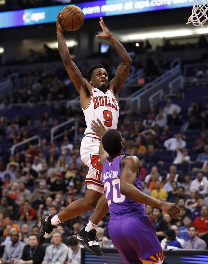 Chicago Bulls guard Antonio Blakeney (9) dunks over Phoenix Suns forward Josh Jackson (20) during the second half of an NBA basketball game, Monday, March 18, 2019, in Phoenix.