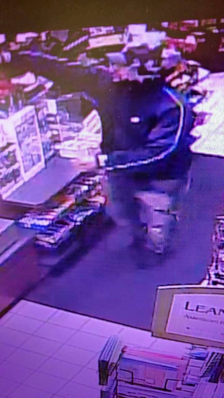 One of two suspects accused of robbing two gas stations Monday evening in Crystal Lake.