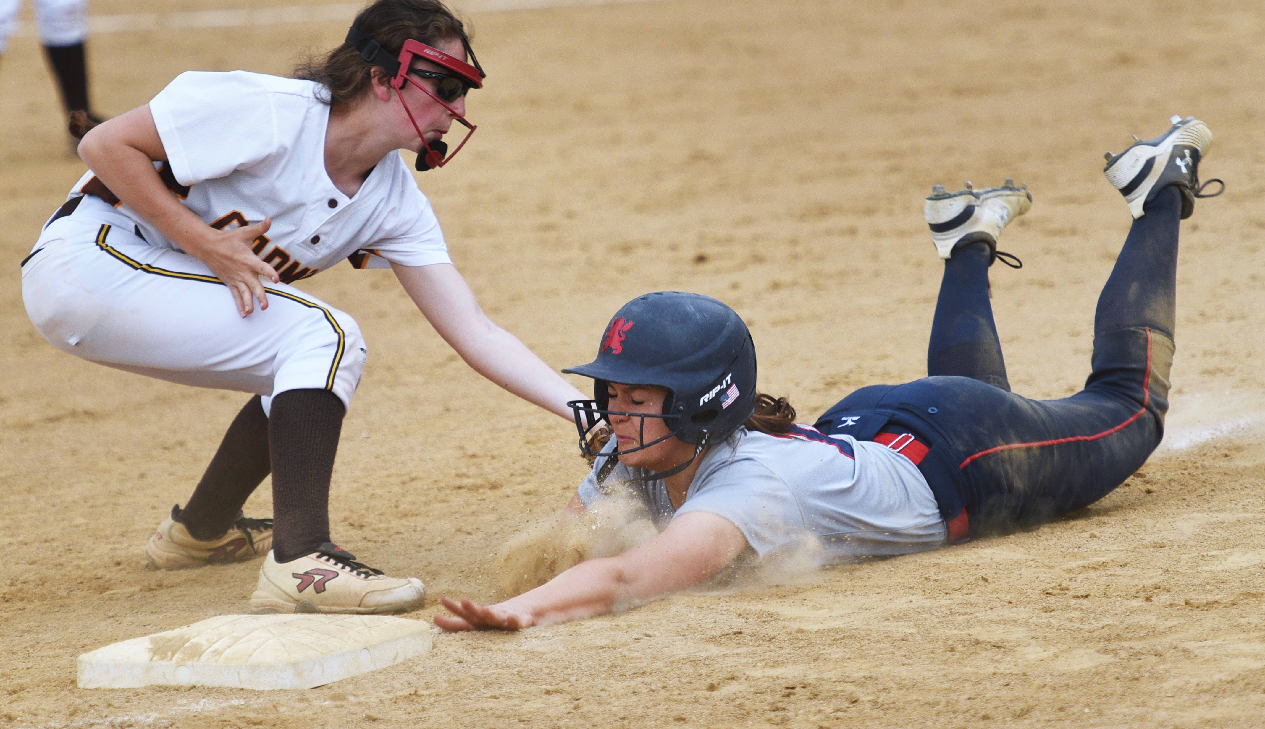 St. Viator's Kyra Hatch, right, is picked off at third base by Carmel's Hailie Swiatkowski during Monday's softball game in Arlington Heights.