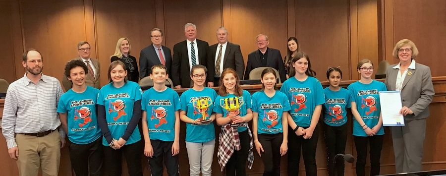 Mount Prospect village leaders, including Mayor Arlene Juracek, on far right, honored the Lincoln Middle School robotics team, aka Lincoln Shrimp Strike Back, at a recent board meeting. The team will compete in the world championships this weekend in Detroit.