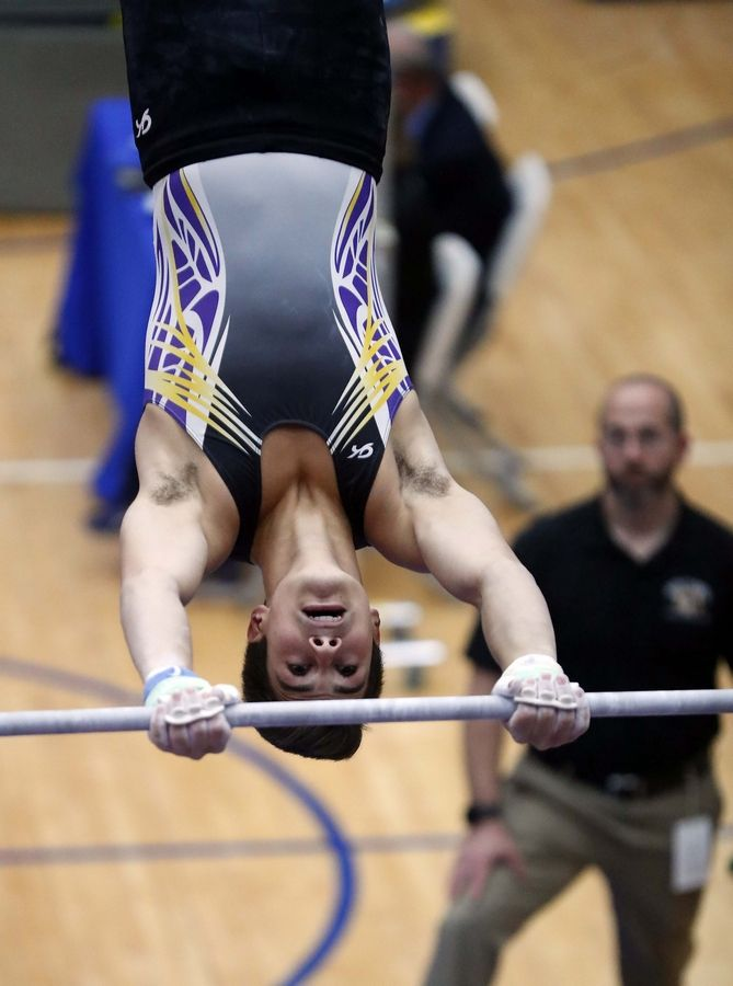 Ben Kowalski of Rolling Meadows High School on the horizontal bar Saturday during the State boys gymnastics meet at Hoffman Estates High School.