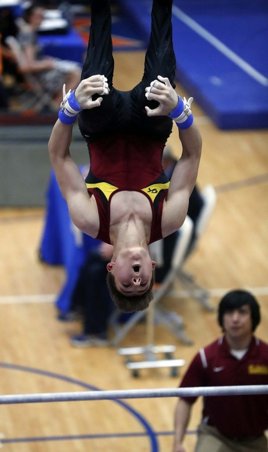 Oscar Kulesza of Schaumburg High School on the horizontal bar Saturday during the State boys gymnastics meet at Hoffman Estates High School.