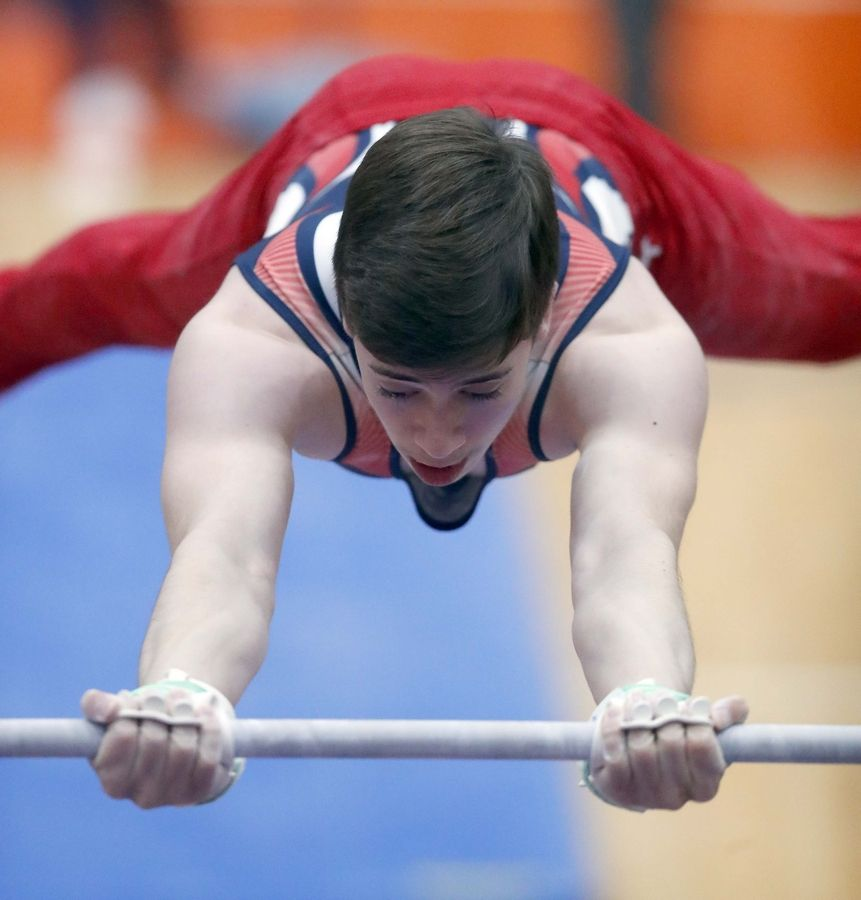 Zachary Taylor of Metea Valley High School on the horizontal bar Saturday during the State boys gymnastics meet at Hoffman Estates High School.