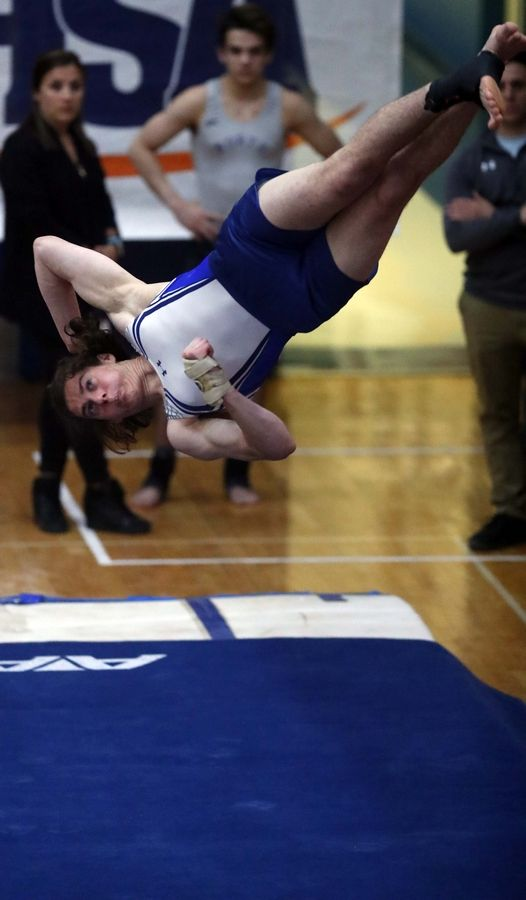 Aaron Busiel of Prospect High School on the floor exercise Saturday during the State boys gymnastics meet at Hoffman Estates High School.