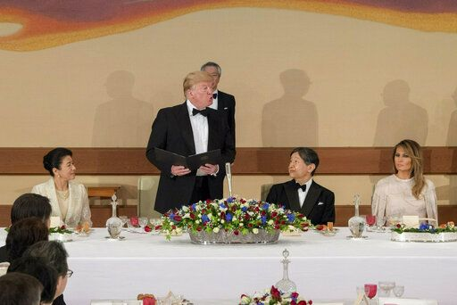 In this photo provided by the Imperial Household Agency of Japan, U.S. President Donald Trump speaks during a state banquet at the Imperial Palace in Tokyo, Japan, Monday, May 27, 2019. From left, Empress Masako, Emperoro Naruhito and first lady Melania Trump.  (Imperial Household Agency of Japan via AP)