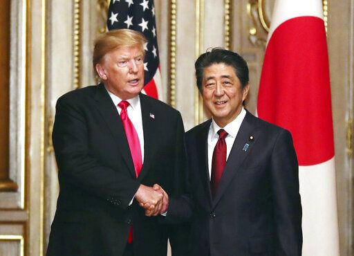 U.S. President Donald Trump, left, shakes hands with Japanese Prime Minister Shinzo Abe prior to their working luncheon at the Akasaka guesthouse in Tokyo Monday, May 27, 2019.  (Yoshikazu Tsuno/Pool Photo via AP)