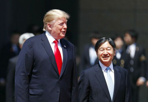 U.S. President Donald Trump, left, is escorted by Japan's Emperor Naruhito during an welcome ceremony at the Imperial Palace in Tokyo Monday, May 27, 2019. (Issei Kato/Pool Photo via AP)