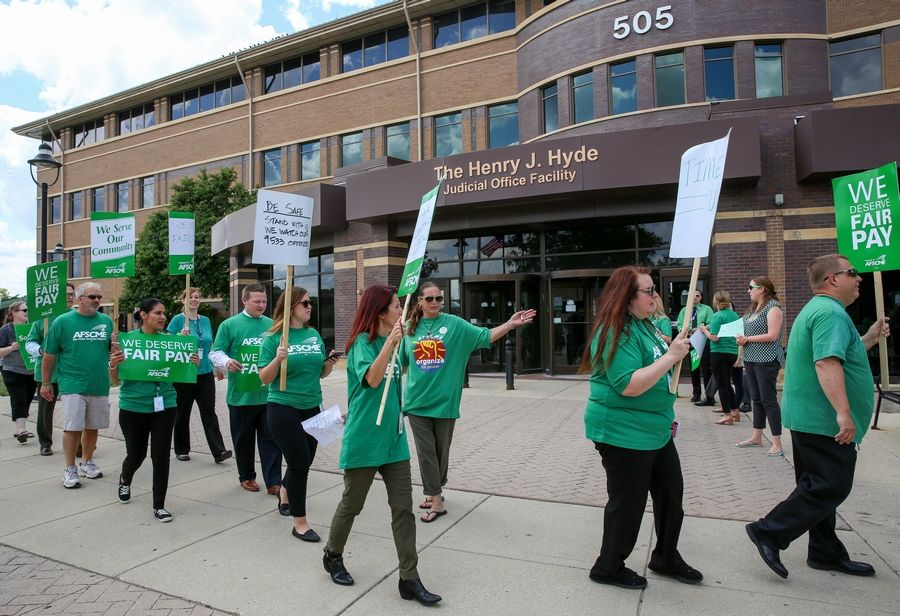 DuPage County probation officers and support staff stage a Tuesday demonstration outside the DuPage County courthouse in Wheaton, demanding a fair contract and decent wages.