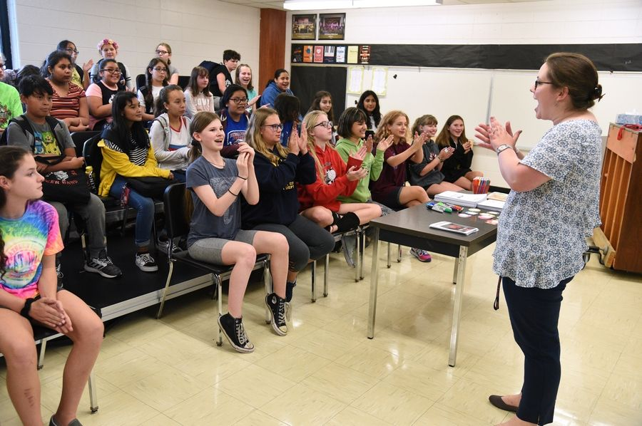 Carl Sandburg Middle School choir students applaud the upgrades to their meeting space after choral director Stevee Bellas, right, revealed the room to students Tuesday at the Mundelein school. Improvements included new chairs and risers, paint and a wall of mirrors.