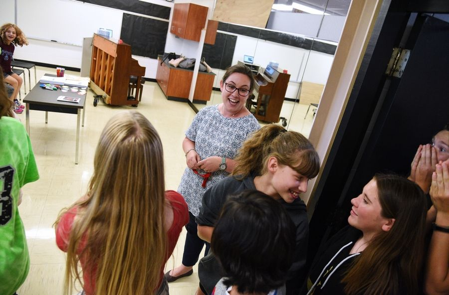 Choral director Stevee Bellas, center, shows students the newly refurbished choir room Tuesday at Carl Sandburg Middle School in Mundelein.