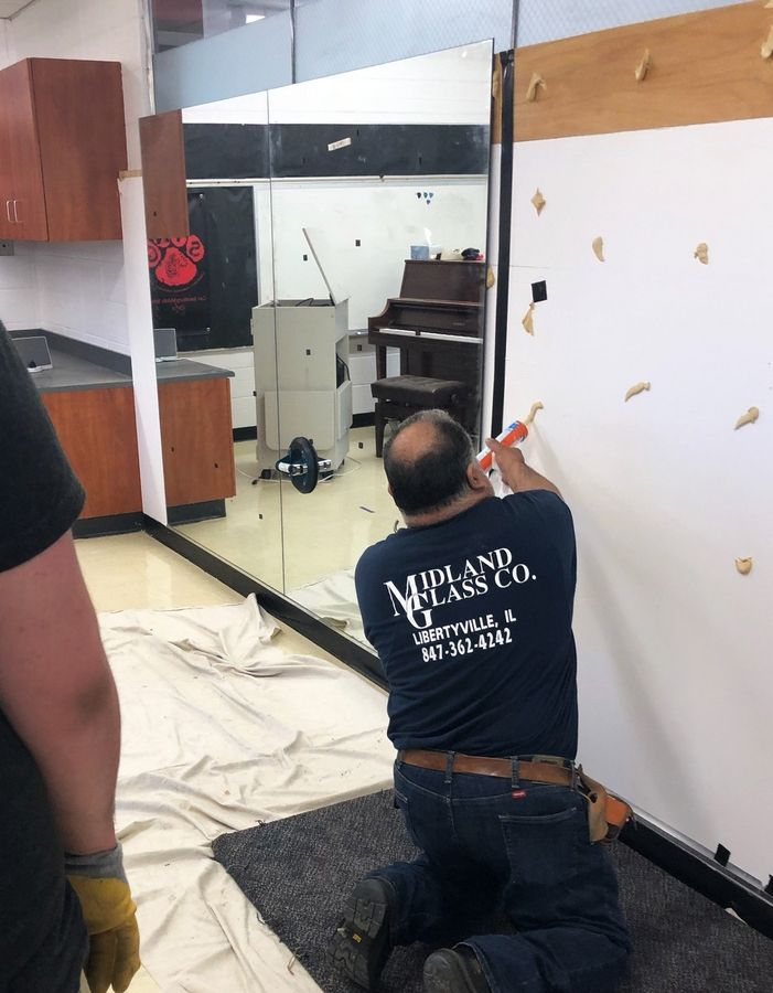 Alex Garcilazo, owner of Midland Glass Co. in Libertyville, donated and installed the five mirror panels during the summer in the Carl Sandburg Middle School choir room at he Mundelein School.