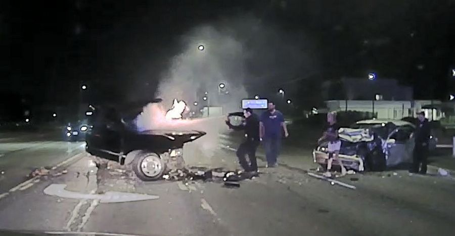 Dashcam video shows Round Lake Beach police Officer Ken Lupi putting out a fire on a burning vehicle after a head-on crash July 14.
