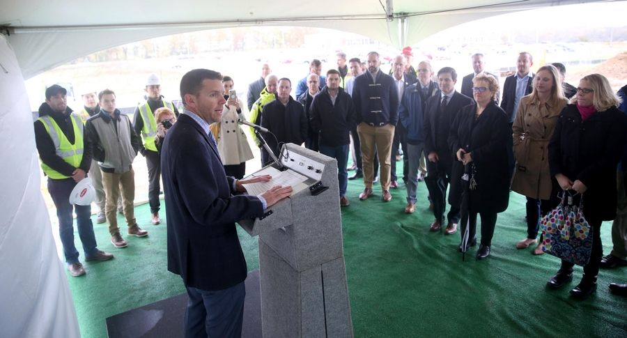Tony DeRosa, vice president of development for Fiduciary Real Estate Development, addresses the crowd Tuesday during a ceremonial groundbreaking for a new 300-unit apartment complex in West Dundee.