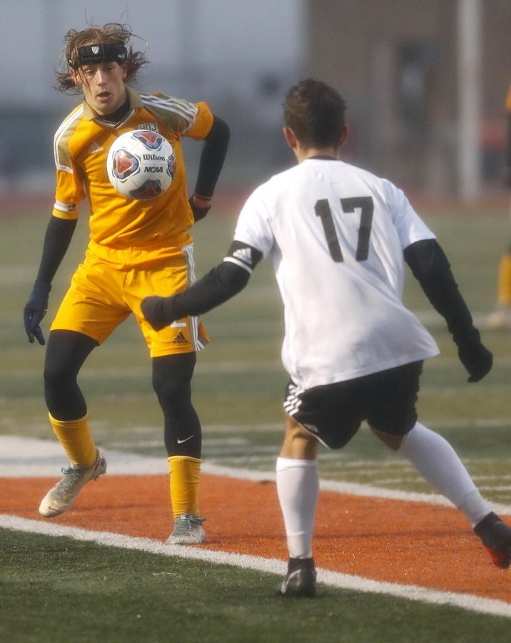 Jacobs' Liam Armstrong corrals the ball against DeKalb in boys sectional soccer action at DeKalb Wednesday night.