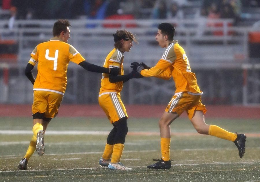From left, Jacobs' Alex Nicastro, Liam Armstrong and Bryan Ramos-Munoz celebrate their fourth goal of the game against DeKalb in boys sectional soccer action at DeKalb Wednesday night.