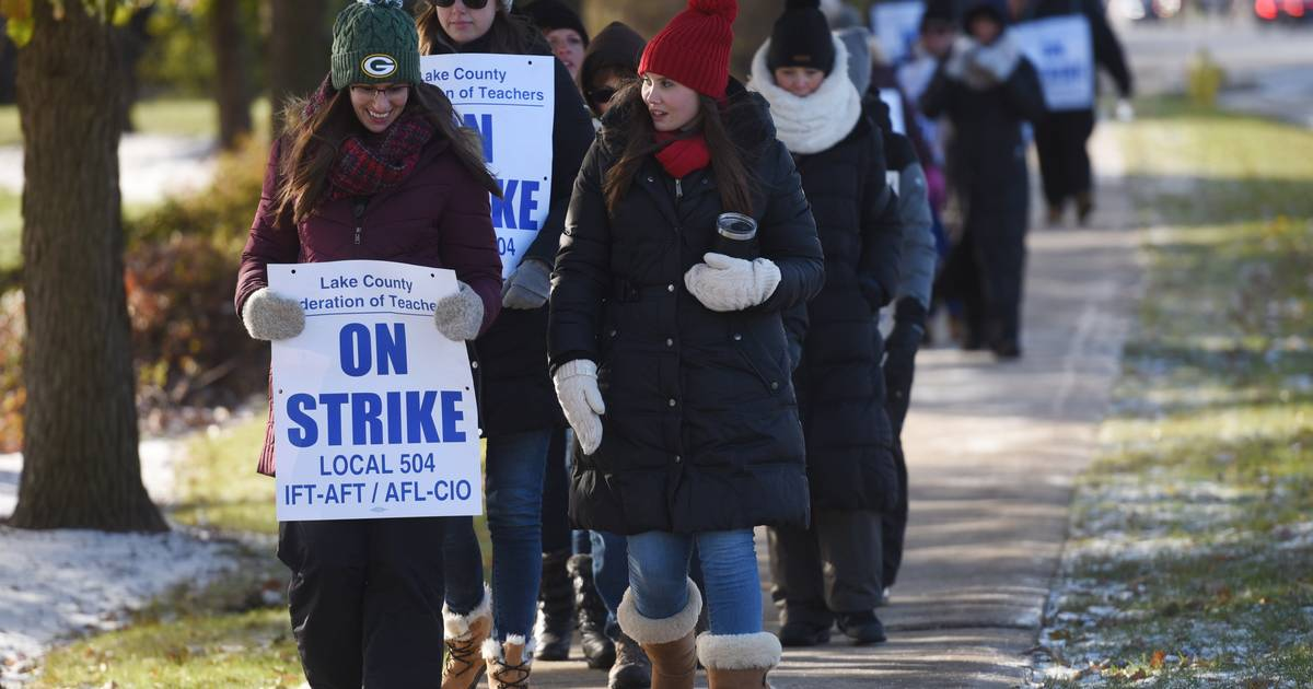 Striking District 46 workers picket in Grayslake