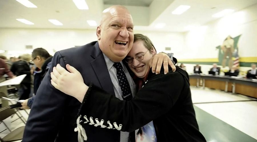 Nova Maday, right, celebrates with ACLU of Illinois spokesperson Ed Yohnka after the Palatine-Schaumburg High School District 211 board of education voted Thursday night at Fremd High School to allow transgender students unrestricted access to locker rooms.