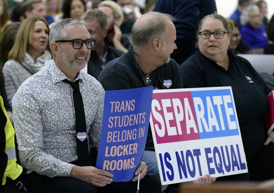 Joe Serio and Paul Dombrowski of Palatine support the measure allowing transgender students unrestricted use of locker rooms.