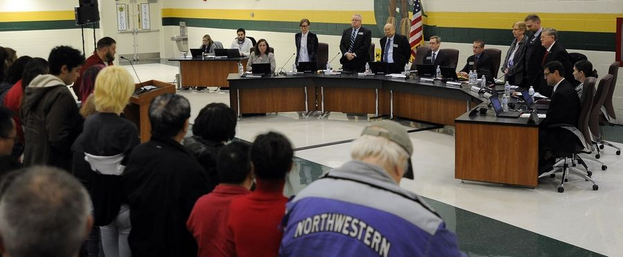 The board members and the audience have a moment of silence for the shooting victims out in California at the Palatine-Schaumburg High School District 211's board of education meeting at Fremd High School earlier Thursday night.