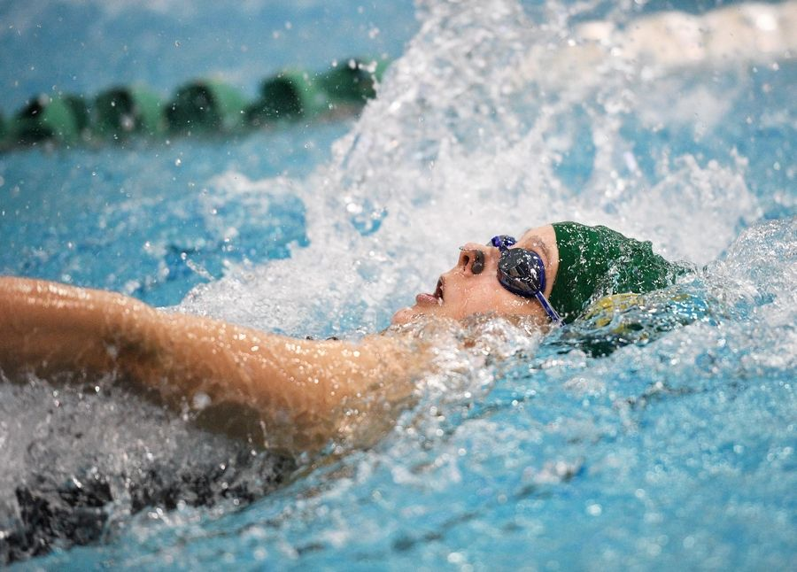 Alexandra Eastmond, of Stevenson High School competes in the 100-yard backstroke at the girls state swimming championships at New Trier High School in Winnetka Saturday.