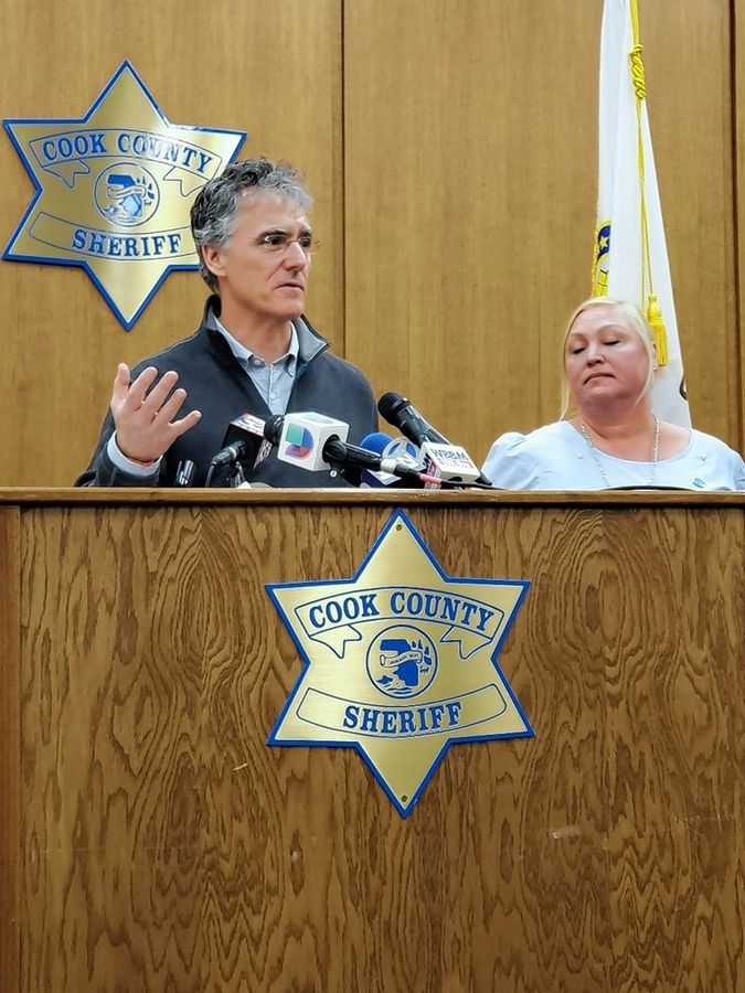 "Cook County Sheriff Tom Dart, left, and Colleen Shinn of Autism Speaks discuss a new program that will provide free scent kits to families, caregivers and social service providers that work with seniors or children who are likely to wander. ""I don't think there's anything more traumatic than when a loved one goes missing,"" Dart said."