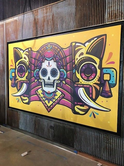 A large mural is part of the decor at the new Guzman y Gomez, a fast-food and fast-casual Mexican restaurant from Australia that opens its first U.S. location Thursday in Naperville.