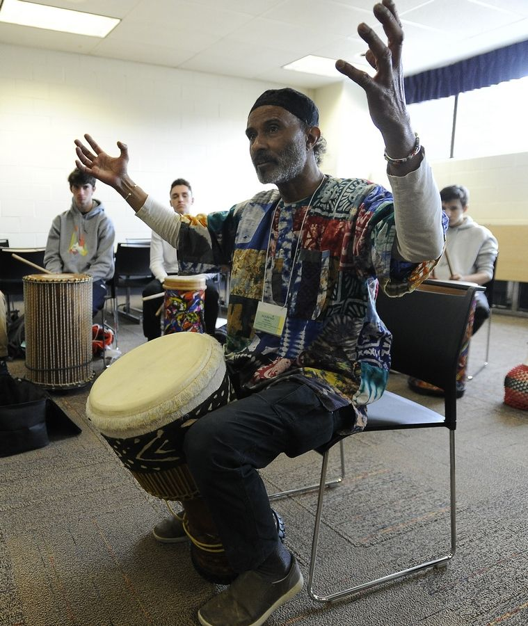 Tony Toneji Garrett teaches Stevenson High School students the fine art of African drumming Tuesday as part of the Lincolnshire school's two-day Odyssey fine arts festival. He offered up drums like the bongo, djembe, djun djun and others that have been heard in Africa for centuries.