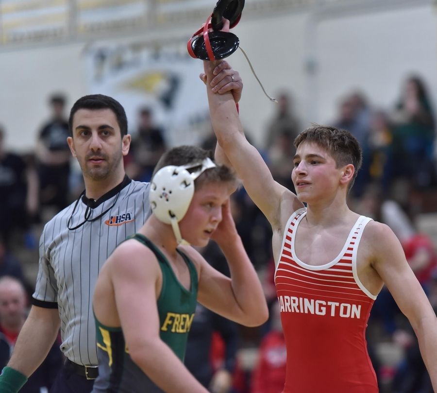 Barrington's Charlie Jones is declared the winner over Fremd's Jake Crandall in their 106-pound championship bout at the Stevenson High School wrestling regional meet in Lincolnshire Saturday.