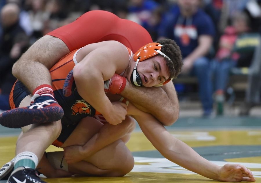 Buffalo Grove's Gio Jackson wrestles with Barrington's Evan Roper in their 220-pound title bout at the Stevenson High School wrestling regional meet in Lincolnshire Saturday.