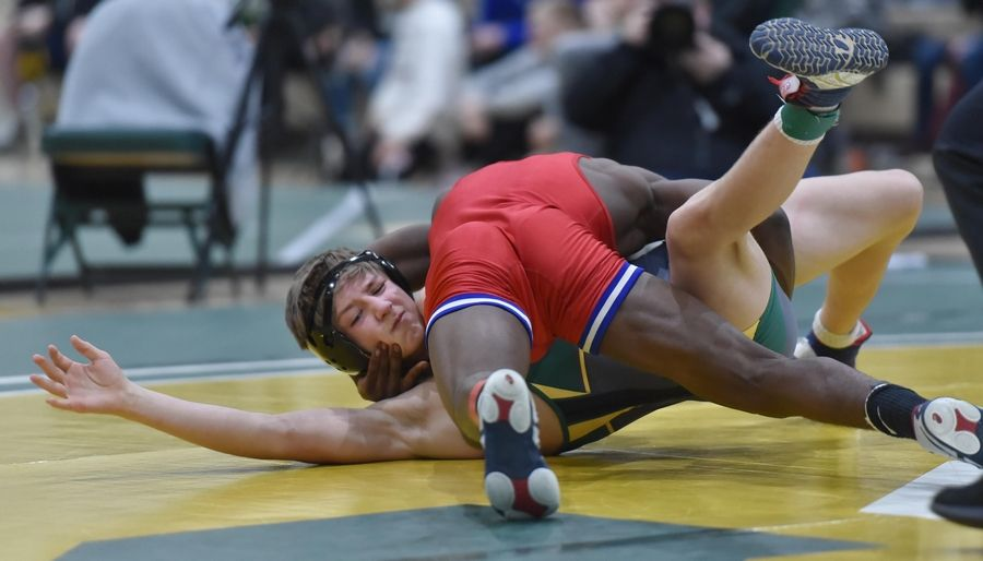 Dundee-Crown's Amaire Jones tries to take control of Fremd's Charlie Fifield in their 126-pound bout at the Stevenson High School wrestling regional meet in Lincolnshire Saturday.