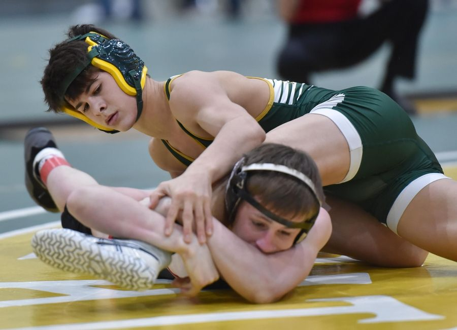 Stevenson's Lorenzo Frezza tries to free himself from Barrington's Brian Beers in their 113-pound championship bout at the Stevenson High School wrestling regional meet in Lincolnshire Saturday.