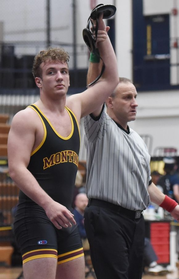 Montini's Josh LaBarbera is declared the winner over South Elgin's Mike Roath in their 220-pound championship bout at the Conant wrestling sectional meet Saturday in Hoffman Estates.
