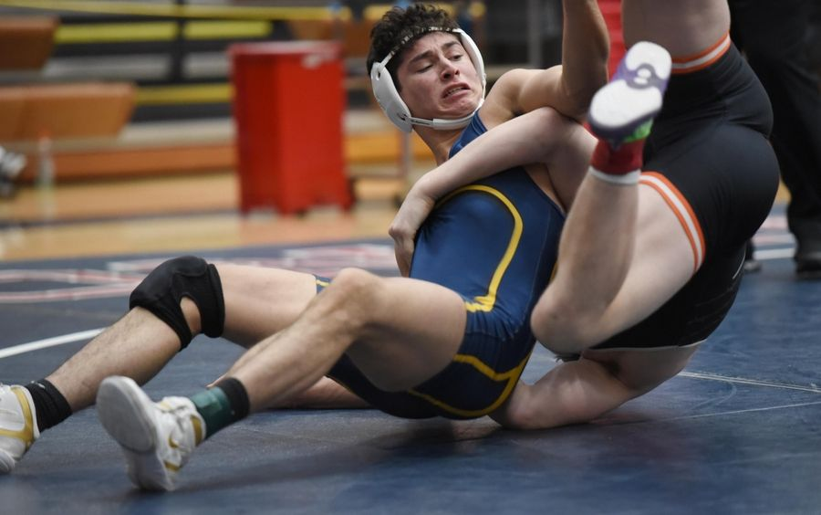 DeKalb's Bradley Gillum and Leyden's Robert Massari wrestle in their 160-pound championship bout at the Conant wrestling sectional meet Saturday in Hoffman Estates.