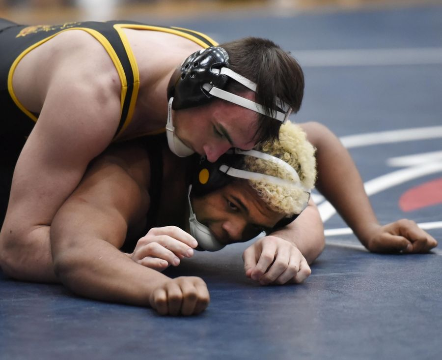 Montini's Trevor Swier controls Glenbard North's Alonzo Smiley wrestle in their 182-pound championship bout at the Conant wrestling sectional meet Saturday in Hoffman Estates.