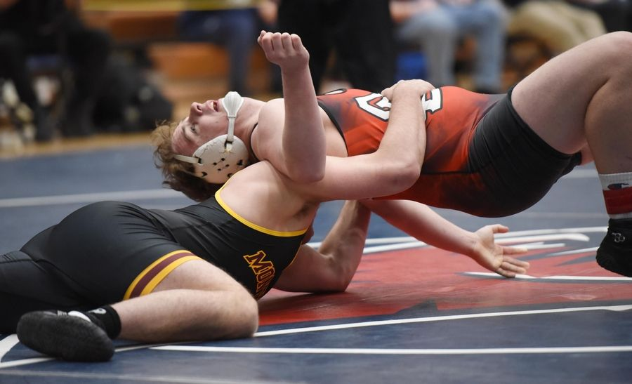 South Elgin's Mike Roath and Montini's Josh LaBarbera wrestle in their 220-pound championship bout at the Conant wrestling sectional meet Saturday in Hoffman Estates.