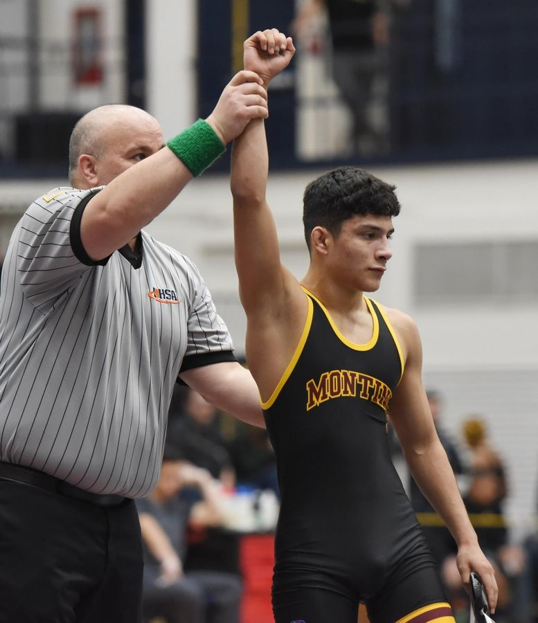 Montini's Nain Vazquez is declared the winner over Glenbrook North's Ronan Schuelke wrestle in their 120-pound championship bout at the Conant wrestling sectional meet Saturday in Hoffman Estates.