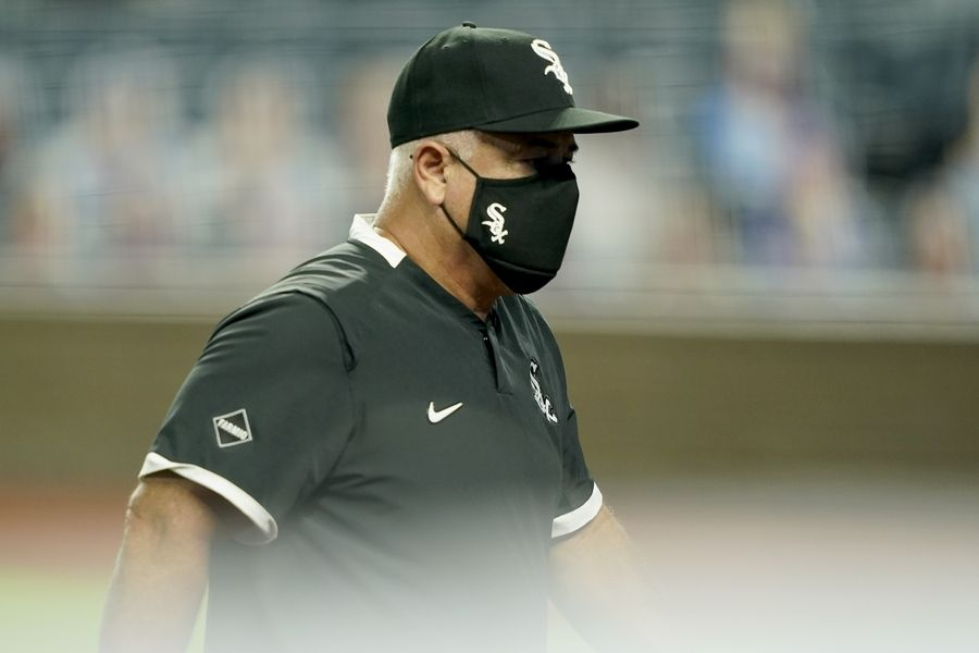 White Sox manager Rick Renteria walks back to the dugout after making a pitching change during the sixth inning of a baseball game against the Kansas City Royals Friday. Major-league baseball has already had to cancel 17 games due to COVID-19 outbreaks. The White Sox and Cubs have stayed relatively healthy, but the game needs to move away from being in danger of completely shutting down.