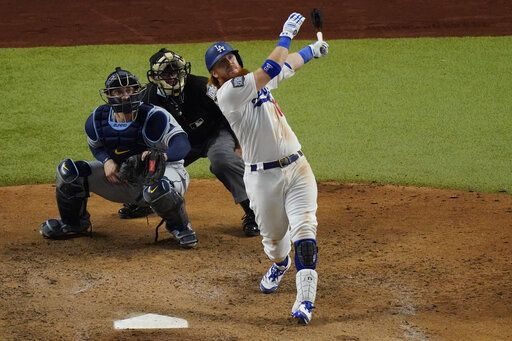 Los Angeles Dodgers' Justin Turner flies out against the Tampa Bay Rays during the sixth inning against the Tampa Bay Rays a baseball World Series Game 6 Tuesday, Oct. 27, 2020, in Arlington, Texas.